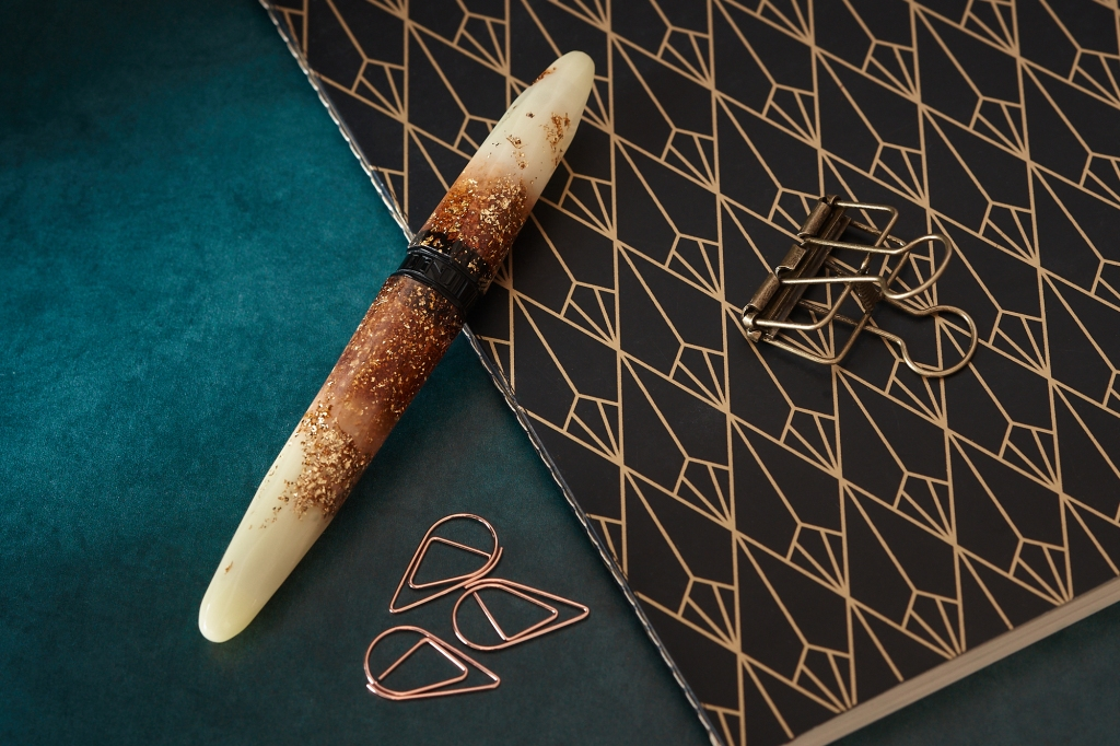 BENU Briolette fountain pen in Luminous Amber. Photographed with a Clairfontaine Deco notebook.