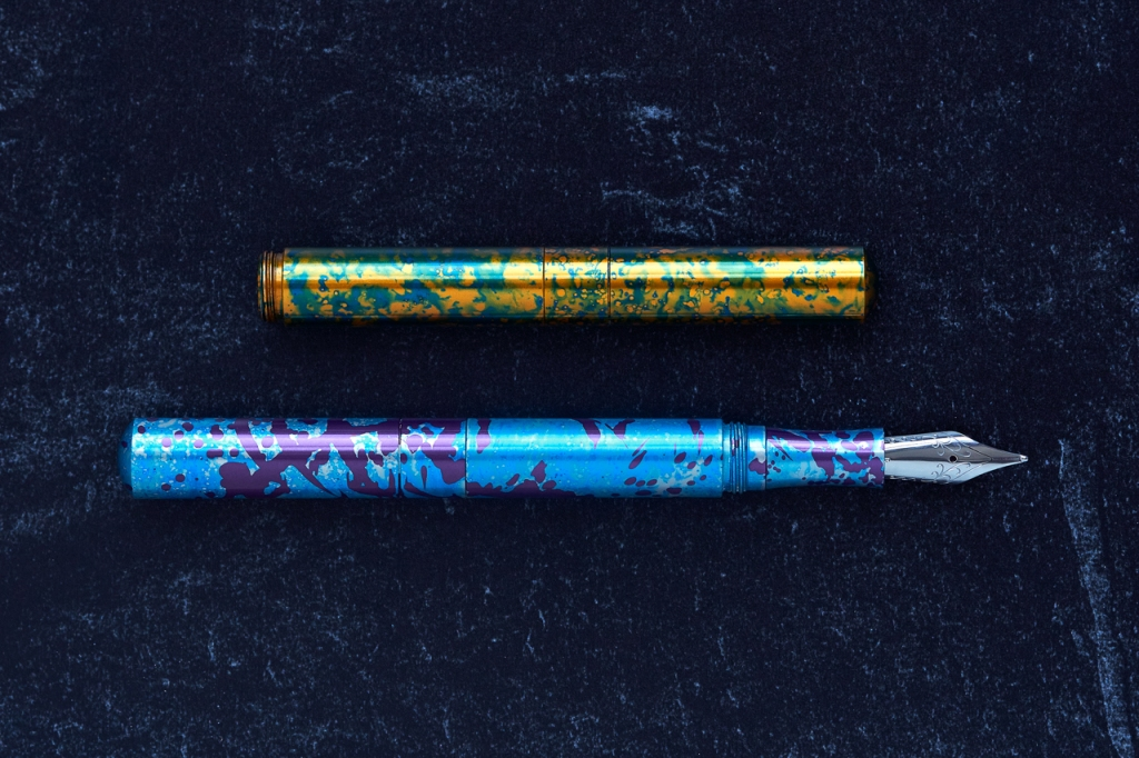 A pair of Schon Pocket Six Fountain pres. The upper pen is in Amphibian 3. The lower pen is in LaCroiy