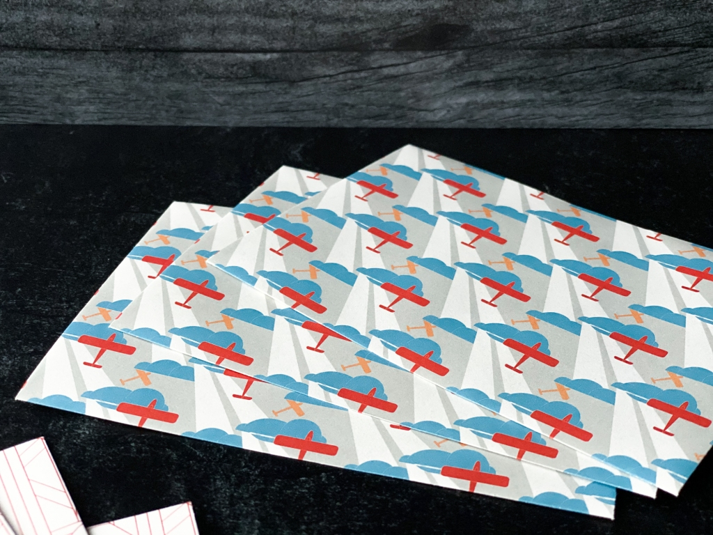 Art Déco envelopes in a pattern featuring red airplanes