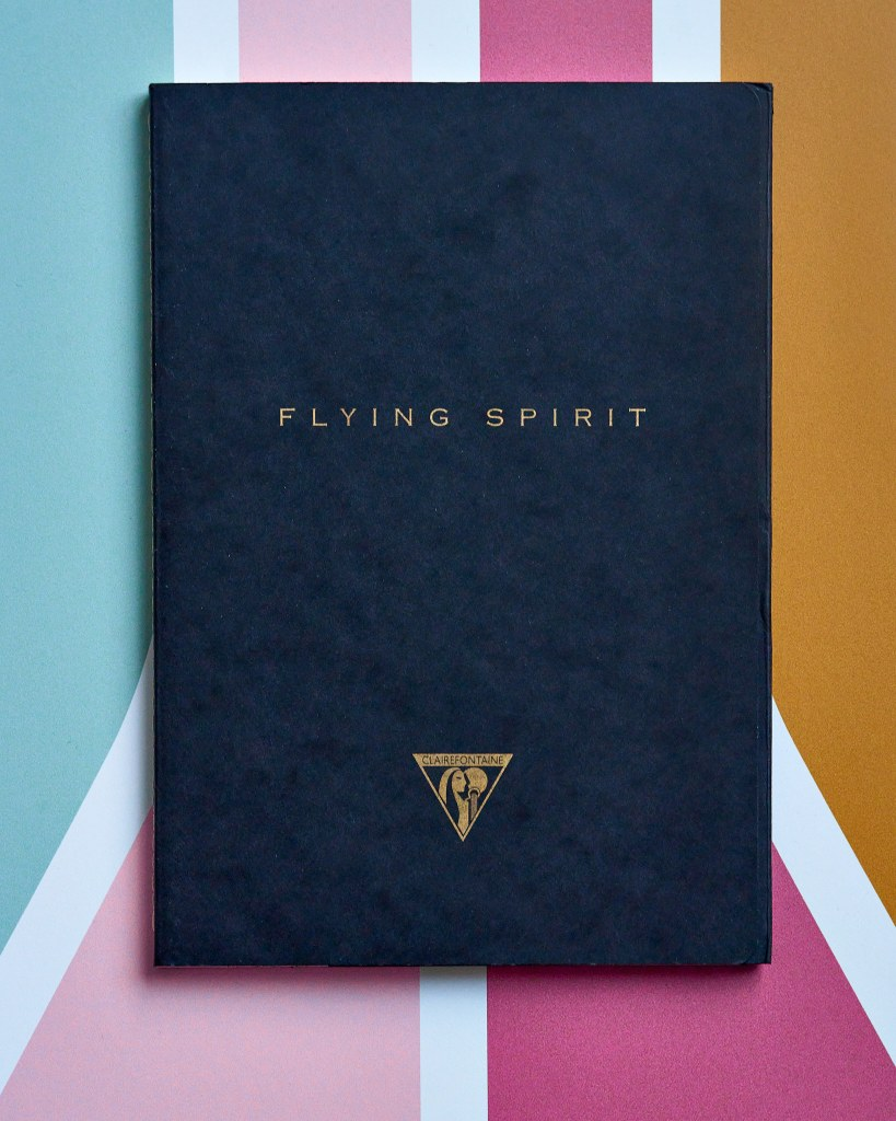 A Clairefontaine black Flying Spirit notebook.